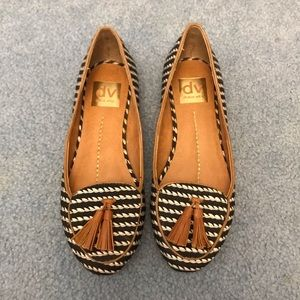Black and white DV flats with brown leather tassel